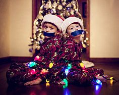 Idea for Christmas Card - lol  Christmas Lights...........$12  Santa Hats....................$8  Blue Tape......................$4  Silent Night....................Priceless    PS. No kids were harmed in the making of this photo! :)