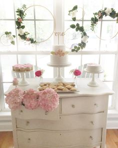 Pink flowers and floral hoops from Floral 1st Birthday Party at Kara's Party…