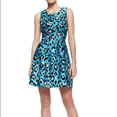 """Michael Kors Turquoise Animal Print Bell Dress This is a stunning NWT Summer Runway Michael Kors Turquoise Animal Print Bell dress. SOLD OUT IN STORES!! Store display from high end Fifth Avenue store! There are some light pulls in the fabric which happens with silk blend when handled. See pictures. Approx measurements 35"""" L from the shoulder to the hem and 17.5"""" from underarm to underarm. Scoop neckline with folded details. Pleated bell skirt. Fully lined. Made in Italy.  Michael Kors…"""