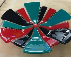 Fused glass bowl in black, red and teal