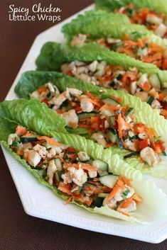 These healthy and Spicy Chicken Lettuce Wraps are filled with a chicken mixture of cucumbers, carrots, bell peppers, green onions, cilantro, and cashews. | tastesbetterfromscratch.com  #healthy #cleaneating #recipe