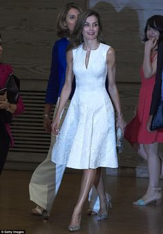 Queen Letizia arrived at the National Fashion Awards 2017 at Museo del Traje and looked the part in a chic white dress offset with her trusty snakeskin stilettos