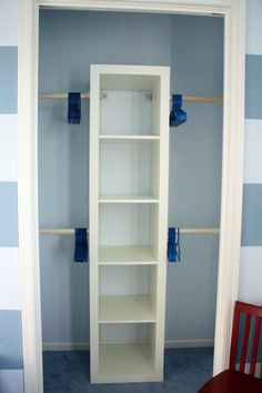 Inexpensive closet organization...get this shelf from ikea and add some tension rods, or screw in wood ones like this. Id also put a board on top for a long shelf.  Would be great for the twins closet!!