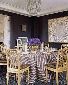 Home of Aerin Lauder: Tablecloth in dining room made of a Jim Thompson silk; ceiling fixture by Emile-Jacques Ruhlmann; painting by Alberto Burri; wall color is a custom mix by Donald Kaufman Color.