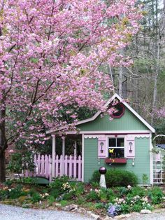Photo by Barbara Stanley - The pink Kwanzan cherry blossoms match the trim on the potting shed. : HGTV Gardens