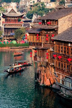 Fenghuang, Hunan, China.   The Taiping of the modern age – this fascinating riverside town of ancient city walls and gate towers, houses on stilts overlooking the river and hoary temples dotted about the old town  /www.lonelyplanet.com/china/hunan/fenghuang#ixzz3AI6rZAXr