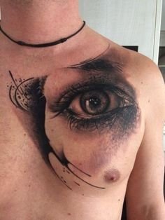 Realistic eye tattoo on chest for men