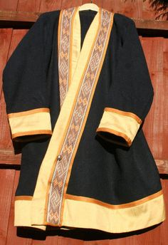 Reconstruction of 7thC warrior coat based on illustration of Taplow princely burial reconstruction within Penelope W. Rogers, Cloth and Clothing in Early Anglo-Saxon England, decorated with braid from Snartemo, Norway. Photograph courtesy D.Wiewiorka