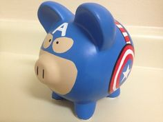 Make sure to check my shop announcement page for any current coupon codes!  MADE TO ORDER. Slight differences may apply.  This Captain America piggy bank is approximately 5 tall, 4 wide, and 5 long. Hand-painted with Martha Stewart Crafts Multi-Surface acrylic paint.  If you would like Ceramic Painting, Diy Painting, Pig Bank, Penny Bank, Personalized Piggy Bank, Ceramic Shop, Martha Stewart Crafts, Cute Piggies, This Little Piggy