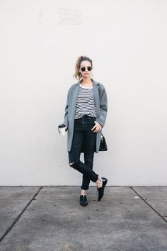 A grey coat and black ripped skinny jeans feel perfectly suited for weekend activities of all kinds. Black leather loafers are a smart choice to complete the look. Shop this look for $93: http://lookastic.com/women/looks/sunglasses-crew-neck-t-shirt-skinny-jeans-coat-crossbody-bag-loafers/7454 — Black Sunglasses — White and Black Horizontal Striped Crew-neck T-shirt — Black Ripped Skinny Jeans — Grey Coat — Black Leather Crossbody Bag — Black Leather Loafers