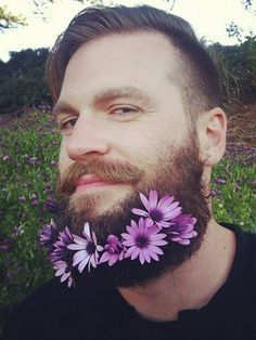 But most recently, the bushy beard's masculinity has been turned off and instead adorned with flower power. Glitter Shorts, Glitter Top, Glitter Wine, Glitter Letters, Glitter Force, Glitter Beards, Shaving Trimmer, Flower Beard, Hair And Beard Styles