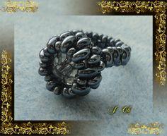 Hematit s průhlednou perlou s černým žíháním