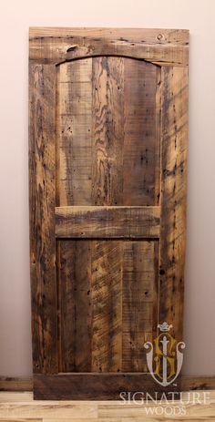 Sliding Style Barn Door made out of reclaimed barn wood. These beautiful reclaimed douglas fir roof boards were used to create this custom arched top door.