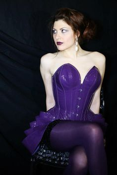 Purple patent leather overbust corset with deep plunge and pointed cups