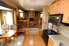 5th wheel with a front living room at Hershey Rv Show RVs
