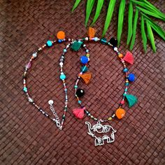 Lucky elephant necklace - Necklace with various beads, pompoms, tassels and an elephant pendant by FlorAccessoires