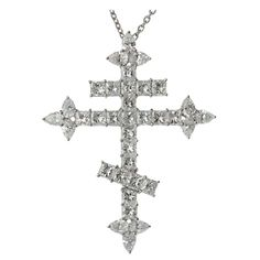 """A stunning Harry Windston Orthodox Cross pendant necklace made in fine platinum and set with an estimated 10.86 carats of sparkling square and pear-cut diamonds. Completed by a 17.5"""" rolo chain. A magnificient and radiant design. 45mm x 58mm Pendant Width - 11.5"""" Chain Length."""