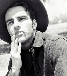 Montgomery Clift photographed by J. R. Eyerman. Great pose and good contrast between black and white. I love the simplicity of this photo and cast shadows on his face.