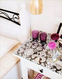 add interest to a boring table with wallpaper