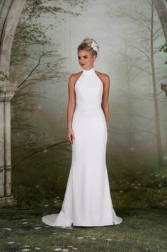 35de6124369 A soft high-necked gown with flattering lace waistline and sequinned lace  train. Emma Bridals