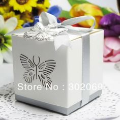 Laser-cut Butterfly favor box $50.00 (104 euros with shipping) for 200 - quality looks better