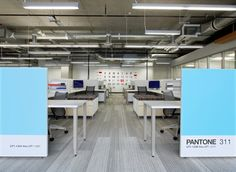 Large calendar on the back wall, Pantone swatches at the front - Inside Adobes New Utah Campus