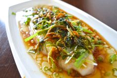 chinese meals Cantonese steamed fish is often served as one of the courses in a Chinese banquet. This Cantonese steamed fish uses fish filets for an easy homemade version. Fish Dishes, Seafood Dishes, Fish And Seafood, Seafood Recipes, Cooking Recipes, Salmon Recipes, Fish Filet Recipes, Tilapia Recipes, Asian Recipes