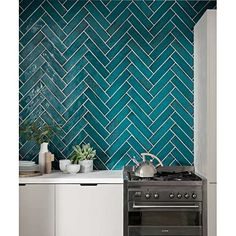 Browse our range of quality kitchen tiles to completely transform your cooking space. From splashbacks to countertops, we have the perfect tiles for your home. Chevron Turquoise, Chevron Tile, Turquoise Kitchen, Geometric Tiles, Turquoise Bathroom, Credence Adhesive, Kitchen Splashback Tiles, Topps Tiles, Herringbone Backsplash