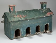 PENNSYLVANIA FOLK ART GREEN-PAINTED CUT-OUT SHEET-IRON BIRD HOUSE, featuring two chimneys and four separate perches with openings. Old green...