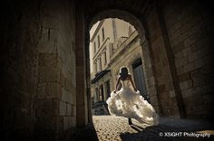 Incredible, the lighting, how she's framed by the archway, dynamic movement.