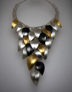 Falling Leaves Necklace by Lynn Christiansen. In sterling silver and 22k gold bimetal. Necklace is 15.5