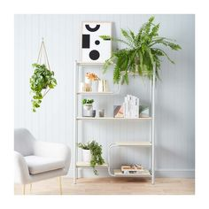 Shelving goals.. There is nothing that Canteen shelving unit from our new friend Industria X can't do. Here in this shot it is flaunting gorgeous vases and book ends, keeping your reading corner fresh all year round. #shelving #bookcase #indoorgreen #velvetchair