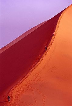 "Climbers on ""Big Red"" in Namibia. Photo by Leo Dos Remedios"