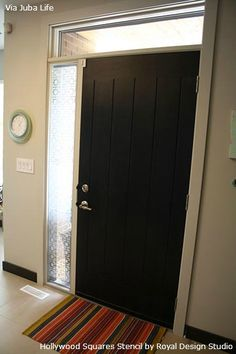Adding pattern & privacy to plain glass door insets by stenciling | Stenciling on Glass | Hollywood Squares Stencil by Royal Design Studio