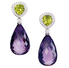 Earrings by Juvelér Langaard. In 750/- white gold set with peridot, amethyst and white brilliant cut diamonds. visit: www.langaard.no