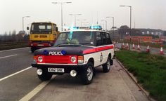 A Greater Manchester Police Range Rover attends the scene of an incident near Barton Bridge in 1988. This is one of a series of images taken to illustrate the work of the Force's Motorway Unit. The Range Rover was the mainstay of the unit for many years due to its strength and versatility. www.mp.police.uk