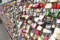 Koln, Germany: Couples take a lock, write or carve their names & date on it, and attach it to the bridge's fence and throw the key into Rhine for love and good luck. I first saw this in Paris & loved it!