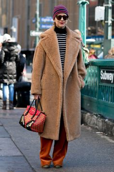 We're betting Natalie Joos is warm and toasty in that gorgeous overcoat. Street Style at New York Fashion Week #NYFW