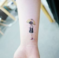 Child under the rainy umbrella tattoo on the inner wrist.