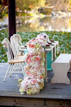 Cascading wedding floral table runner