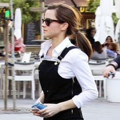 Overalls Done Right! Emma Watson Kicks Her Street Style Up a Notch With Slip-OnSneaks