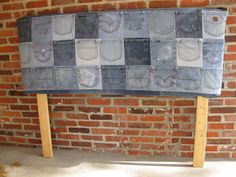 Blue jean pockets and an old door made a great headboard for storage of those little things that are hard to keep track of.  Used in the KCSA 2012 Showhouse, this headboard is also seen in the newly published Home Colors 110+ Tips to Create Your Dream Home on newsstands now.  Designed by Kacy Childs-Winston.