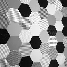 Settecento'shexagon tile ina monochrome palette and incorporating with texture for the surface.