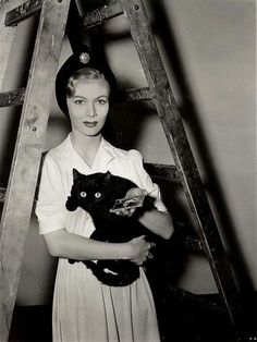 "Veronica Lake bad luck triumvirate: black cat, ladder, broken mirror, 1940s-- possibly publicity for ""I Married a Witch""..."