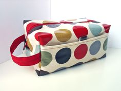 Boxy Bag Knitting Project Zippered Pouch in cinnamon brown with red dots Oilcloth by dotty spots. $30.00, via Etsy.