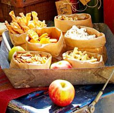 No one likes to reach deep into a greasy bag of chips, so transfer snacks to rolled-down brown lunch bags set on a tray for a tied-together look.