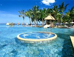 View of the jacuzzi and the pool at La Pirogue Resort & Spa, Mauritius Mauritius Hotels, Mauritius Island, Mauritius Travel, Jacuzzi, Resorts, Places To Travel, Places To See, Honeymoon Special, Travel Tours
