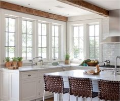 White kitchen, lots of windows/natural light.