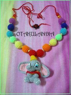 Collar de lactancia y porteo mod. DUMBO - producto exclusivo de Otakulandia diseñado y realizado a mano en crochet para el disfrute de la mamá y el bebé mientras le tengas en brazos.
