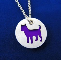 A colorful charm pendant with a sterling silver Chihuahua silhouette. by…